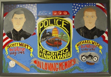 A mural painted by youth from the Police Athletic League of the Olivets Boys & Girls Club depicts the portraits of two Reading Police Officers who were killed in the line of duty.